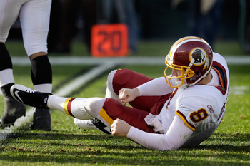 PHILADELPHIA, PA - JANUARY 01: Quarterback Rex Grossman #8 of the Washington Redskins gets up after being hit against the Philadelphia Eagles at Lincoln Financial Field on January 1, 2012 in Philadelphia, Pennsylvania.  (Photo by Rob Carr/Getty Images)
