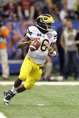 NEW ORLEANS, LA - JANUARY 03:  Denard Robinson #16 of the Michigan Wolverines looks to pass as he rolls out of the pocket against the Virginia Tech Hokies during the Allstate Sugar Bowl at Mercedes-Benz Superdome on January 3, 2012 in New Orleans, Louisia