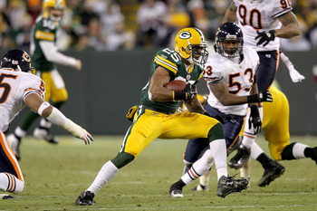 Chicago's defense tries to stop Ryan Grant in the Bears' Christmas Day loss to Green Bay.