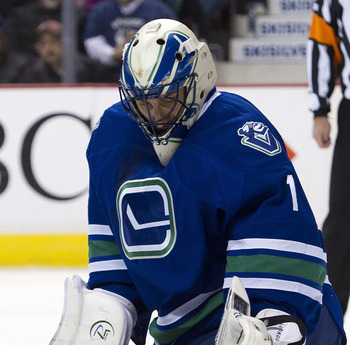 VANCOUVER, CANADA - JANUARY 21: Goalie Roberto Luongo #1of the Vancouver Canucks stops a shot from the San Jose Sharks during the first period in NHL action on January 21, 2012 at Rogers Arena in Vancouver, British Columbia, Canada.  (Photo by Rich Lam/Ge