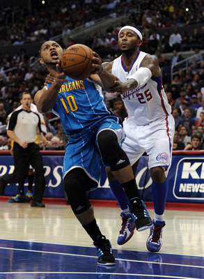 LOS ANGELES, CA - APRIL 22:  Eric Gordon #10 of the New Orleans Hornets is fouled by Mo Williams #25 of the Los Angeles Clippers during the first half at Staples Center on April 22, 2012 in Los Angeles, California.  NOTE TO USER: User expressly acknowledg
