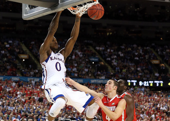 NEW ORLEANS, LA - MARCH 31:  Thomas Robinson #0 of the Kansas Jayhawks dunks the ball against Aaron Craft #4 of the Ohio State Buckeyes in the second half during the National Semifinal game of the 2012 NCAA Division I Men's Basketball Championship at the