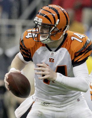 HOUSTON, TX - JANUARY 7: Quarterback Andy Dalton #14 of the Cincinnati Bengals rushes against the Houston Texans during their 2012 AFC Wild Card Playoff game at Reliant Stadium on January 7, 2012 in Houston, Texas. Texas won 31 to 10. (Photo by Thomas B.