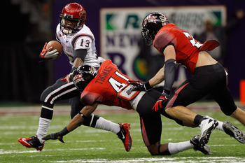 San Diego State running back Ronnie Hillman breaks a tackle in SDSU's bowl game against Louisiana-Lafayette. Hillman is now on the Denver Broncos.