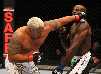Mark Hunt lands a stiff left before his combination that knocked out Cheick Kongo. Photo by Al Bello/Zuffa LLC/Zuffa LLC via Getty Images.