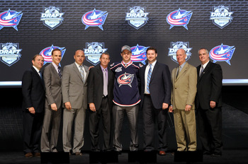 PITTSBURGH, PA - JUNE 22: NHL commissioner Gary Bettman (L) poses with Ryan Murray (4th R), second overall pick by the Columbus Blue Jackets, and Blue Jackets representatives on stage during Round One of the 2012 NHL Entry Draft at Consol Energy Center on