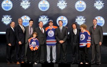 PITTSBURGH, PA - JUNE 22: NHL commissioner Gary Bettman (L) poses with Neil Yakupov (C), first overall pick by the Edmonton Oilers, and Oilers team representatives on stage during Round One of the 2012 NHL Entry Draft at Consol Energy Center on June 22, 2
