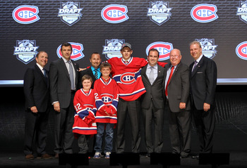 PITTSBURGH, PA - JUNE 22: NHL Commissioner Gary Bettman (L) poses with Alex Galchenyuk (4th R), third overall pick by the Montreal Canadiens and Canadiens representatives on stage during Round One of the 2012 NHL Entry Draft at Consol Energy Center on Jun