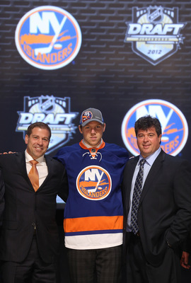 PITTSBURGH, PA - JUNE 22:  Griffin Reinhart, fourth overall pick by the New York Islanders, poses on stage with Islanders representatives during Round One of the 2012 NHL Entry Draft at Consol Energy Center on June 22, 2012 in Pittsburgh, Pennsylvania.  (