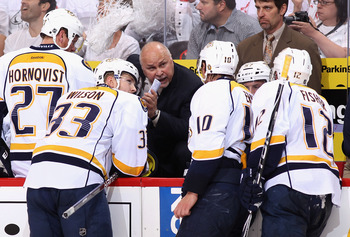 GLENDALE, AZ - MAY 07:  Head coach Barry Trotz of the Nashville Predators talks with Colin Wilson #33,  Martin Erat #10 and Mike Fisher #12 during a time out from Game Five of the Western Conference Semifinals against the Phoenix Coyotes during the 2012 N