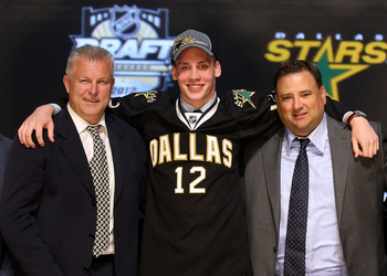 PITTSBURGH, PA - JUNE 22:  Radek Faksa, 13th overall pick by the Dallas Stars, poses on stage with Stars representatives during Round One of the 2012 NHL Entry Draft at Consol Energy Center on June 22, 2012 in Pittsburgh, Pennsylvania.  (Photo by Bruce Be