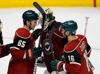 ST PAUL, MN - APRIL 5: Tyler Cuma #35 and Jason Zucker #16 of the Minnesota Wild congratulate Josh Harding #37 following a win against the Chicago Blackhawks on April 5, 2012 at Xcel Energy Center in St Paul, Minnesota. The Wild defeated the Blackhawks 2-