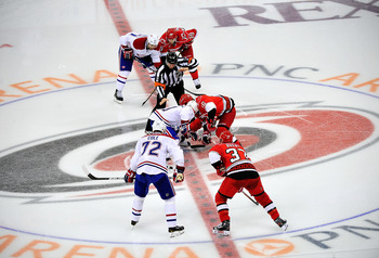 RALEIGH, NC - APRIL 05:  The Montreal Canadiens face off against the Carolina Hurricanes during play at PNC Arena on April 5, 2012 in Raleigh, North Carolina. The Hurricanes won 2-1 by shootout.  (Photo by Grant Halverson/Getty Images)