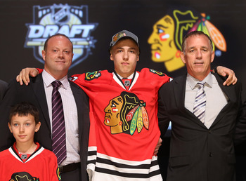 PITTSBURGH, PA - JUNE 22:  Teuvo Teravainen (C), 18th overall pick by the Chicago Blackhawks, poses with Blackhawks representatives on stage during Round One of the 2012 NHL Entry Draft at Consol Energy Center on June 22, 2012 in Pittsburgh, Pennsylvania.