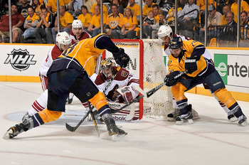 NASHVILLE, TN - MAY 04:  Matt Halischuk #24 of the Nashville Predators tries to get his stick on the puck in front of goalie Mike Smith #41 of the Phoenix Coyotes in Game Four of the Western Conference Semifinals during the 2012 NHL Stanley Cup Playoffs a