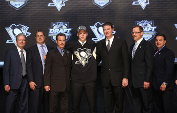 PITTSBURGH, PA - JUNE 22:  Olli Maatta (C), 22nd overall pick by the Pittsburgh Penguins, poses with Penguins co-owner Mario Lemieux (3rd R) and team representatives on stage during Round One of the 2012 NHL Entry Draft at Consol Energy Center on June 22,