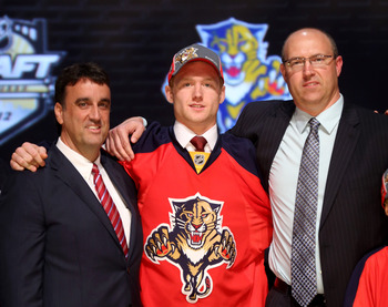 PITTSBURGH, PA - JUNE 22:  Michael Matheson (C), 23rd overall pick by the Florida Panthers, poses with Panthers representatives on stage during Round One of the 2012 NHL Entry Draft at Consol Energy Center on June 22, 2012 in Pittsburgh, Pennsylvania.  (P