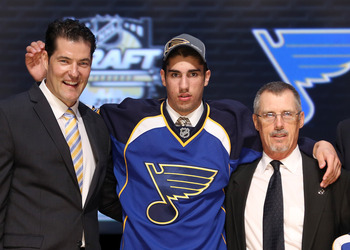 PITTSBURGH, PA - JUNE 22:  Jordan Schmaltz (C), 25th overall pick by the St. Louis Blues, poses with Blues representatives on stage during Round One of the 2012 NHL Entry Draft at Consol Energy Center on June 22, 2012 in Pittsburgh, Pennsylvania.  (Photo