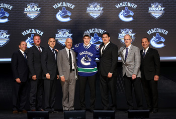 PITTSBURGH, PA - JUNE 22: NHL commissioner Gary Bettman (L) poses with Brendan Gaunce (4th R), 26th overall pick by the Vancouver Canucks, and Canucks representatives on stage during Round One of the 2012 NHL Entry Draft at Consol Energy Center on June 22