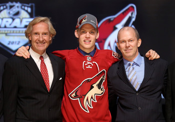 PITTSBURGH, PA - JUNE 22:  Henrik Samuelsson (C), 27th overall pick by the Phoenix Coyotes, poses with Coyotes representatives on stage during Round One of the 2012 NHL Entry Draft at Consol Energy Center on June 22, 2012 in Pittsburgh, Pennsylvania.  (Ph