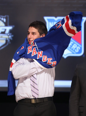 PITTSBURGH, PA - JUNE 22:  Brady Skjei, 28th overall pick by the New York Rangers, puts a jersey on on stage during Round One of the 2012 NHL Entry Draft at Consol Energy Center on June 22, 2012 in Pittsburgh, Pennsylvania.  (Photo by Bruce Bennett/Getty