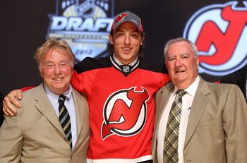 PITTSBURGH, PA - JUNE 22:  Stefan Matteau (C), 29th overall pick by the New Jersey Devils, poses with Devils representatives on stage during Round One of the 2012 NHL Entry Draft at Consol Energy Center on June 22, 2012 in Pittsburgh, Pennsylvania.  (Phot