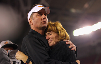 GLENDALE, AZ - JANUARY 02:  Head coach Mike Gundy of the Oklahoma State Cowboys hugs Shelly Budke on stage after Oklahoma State Cowboys won 41-38 in overtime against the Stanford Cardinal during the Tostitos Fiesta Bowl on January 2, 2012 at University of
