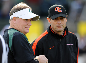 EUGENE, OR - NOVEMBER 26: Head Coach Chip Kelly of the Oregon Ducks and head coach Mike Riley of the Oregon State Beavers chat on the field before the game at Autzen Stadium on November 26, 2011 in Eugene, Oregon. (Photo by Steve Dykes/Getty Images)