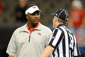 NEW ORLEANS, LA - NOVEMBER 10:  Kevin Sumlin, head coach of the University of Houston Cougars discusses a call with an official during a game against the Tulane Green Wave being held at the Mercedes-Benz Superdome on November 10, 2011 in New Orleans, Loui