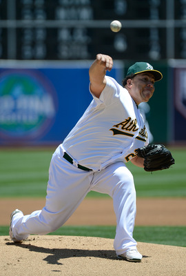 OAKLAND, CA - JUNE 17:  Bartolo Colon #21 of the Oakland Athletics pitches against the San Diego Padres during an interleague game at O.co Coliseum on June 17, 2012 in Oakland, California.  (Photo by Thearon W. Henderson/Getty Images)