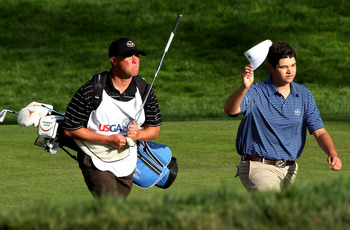 SAN FRANCISCO, CA - JUNE 16:  Amateur Beau Hossler of the United States walks to the 18th green with his caddie Bill Schellenberg during the third round of the 112th U.S. Open at The Olympic Club on June 16, 2012 in San Francisco, California.  (Photo by A