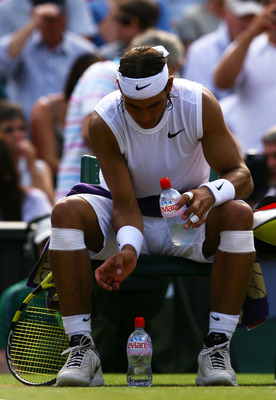 LONDON - JULY 04:  Rafael Nadal of Spain rearranges his water bottles after a game during the men's singles Semi Final match against Rainer Schuettler of Germany on day eleven of the Wimbledon Lawn Tennis Championships at the All England Lawn Tennis and C