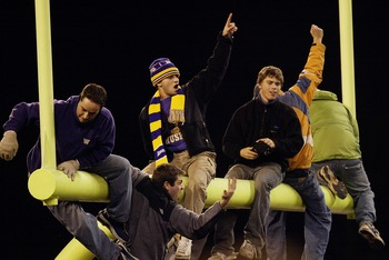 SEATTLE - NOVEMBER 22:  University of Washington Huskies fans climb the goal post after the Huskies beat the Washington State University Cougars 27-19 on November 22 2003 at Husky Stadium in Seattle, Washington. (Photo by Otto Greule Jr/Getty Images)
