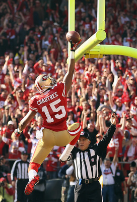 Michael Crabtree dunks the ball over the goal post after a touchdown