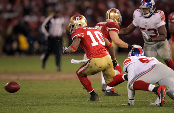Kyle Williams loses the ball against the Giants