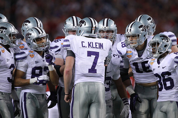 ARLINGTON, TX - JANUARY 06:  Collin Klein #7 of the Kansas State Wildcats huddles the offense against the Arkansas Razorbacks during the Cotton Bowl at Cowboys Stadium on January 6, 2012 in Arlington, Texas.  (Photo by Ronald Martinez/Getty Images)