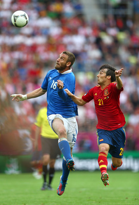 GDANSK, POLAND - JUNE 10:  Daniele De Rossi of Italy and David Silva of Spain fight for the ball during the UEFA EURO 2012 group C match between Spain and Italy at The Municipal Stadium on June 10, 2012 in Gdansk, Poland.  (Photo by Michael Steele/Getty I