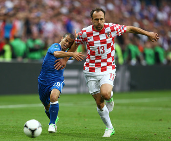POZNAN, POLAND - JUNE 14:  Gordon Schildenfeld of Croatia and  Sebastian Giovinco of Italy battle for the ball during the UEFA EURO 2012 group C match between Italy and Croatia at The Municipal Stadium on June 14, 2012 in Poznan, Poland.  (Photo by Clive