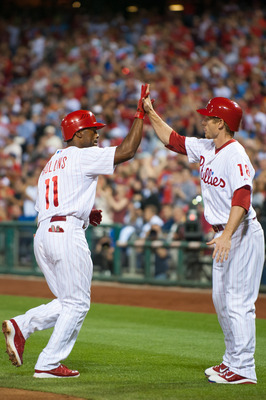PHILADELPHIA, PA - JUNE 6: Jimmy Rollins #11 of the Philadelphia Phillies hi-fives Mike Fontenot #18 after hitting a 2-run home run in the fifth inning during the game against the Los Angeles Dodgers at Citizens Bank Park on June 6, 2012 in Philadelphia,