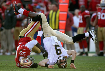 Aldon Smith upends Drew Brees.