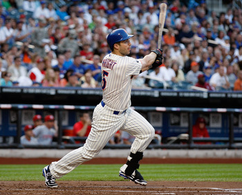 NEW YORK, NY - JUNE 16:  David Wright #5 of the New York Mets hits an RBI single in the first-inning against the Cincinnati Reds at CitiField on June 16, 2012 in the Flushing neighborhood of the Queens borough of New York City.  (Photo by Mike Stobe/Getty