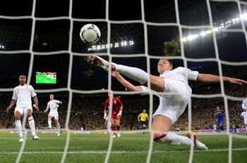 DONETSK, UKRAINE - JUNE 19:  John Terry of England clears an effort from  Marko Devic of Ukraine off the line during the UEFA EURO 2012 group D match between England and Ukraine at Donbass Arena on June 19, 2012 in Donetsk, Ukraine.  (Photo by Laurence Gr
