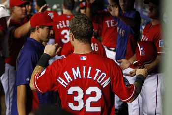 ARLINGTON, TX - JUNE 28: Josh Hamilton #32 of the Texas Rangers celebrates in the dugout after scoring against the Oakland Athletics at Rangers Ballpark in Arlington on June 28, 2012 in Arlington, Texas. (Photo by Rick Yeatts/Getty Images)