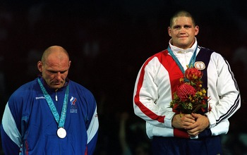 A dejected Alexandr Karelin and a jubiliant Rulon Gardner