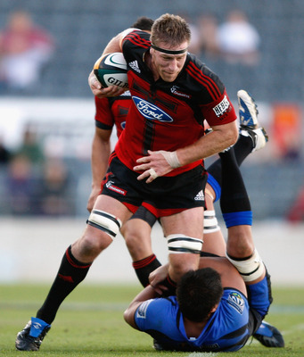 CHRISTCHURCH, NEW ZEALAND - MARCH 14:  Brad Thorn of the Crusaders is tackled by Tamaiti Horua of the Western Force  during the round five Super 14 match between the Crusaders and the Western Force at AMI Stadium on March 14, 2009 in Christchurch, New Zea