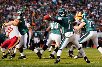 Brian Orakpo (left) getting held by an Eagles offensive lineman.