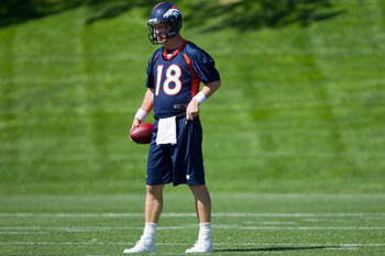 ENGLEWOOD, CO - MAY 21:  Quarterback Peyton Manning #18 of the Denver Broncos looks on during organized team activities at Dove Valley on May 21, 2012 in Englewood, Colorado. (Photo by Justin Edmonds/Getty Images)