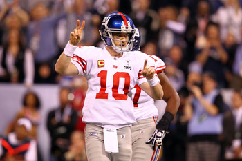 INDIANAPOLIS, IN - FEBRUARY 05:  Eli Manning #10 of the New York Giants gestures against the New England Patriots during Super Bowl XLVI at Lucas Oil Stadium on February 5, 2012 in Indianapolis, Indiana. The Giants won 21-20.  (Photo by Al Bello/Getty Ima