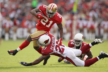 SAN FRANCISCO, CA - NOVEMBER 20:  Frank Gore #21 of the San Francisco 49ers is tackled by Patrick Peterson #21 of the Arizona Cardinals at Candlestick Park on November 20, 2011 in San Francisco, California.  (Photo by Ezra Shaw/Getty Images)