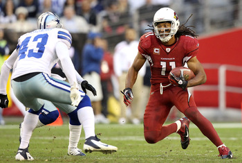 GLENDALE, AZ - DECEMBER 04:  Wide receiver Larry Fitzgerald #11 of the Arizona Cardinals runs with the football after a reception against the Dallas Cowboys  during the NFL game at the University of Phoenix Stadium on December 4, 2011 in Glendale, Arizona
